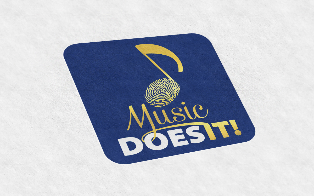 Music Does It Logo
